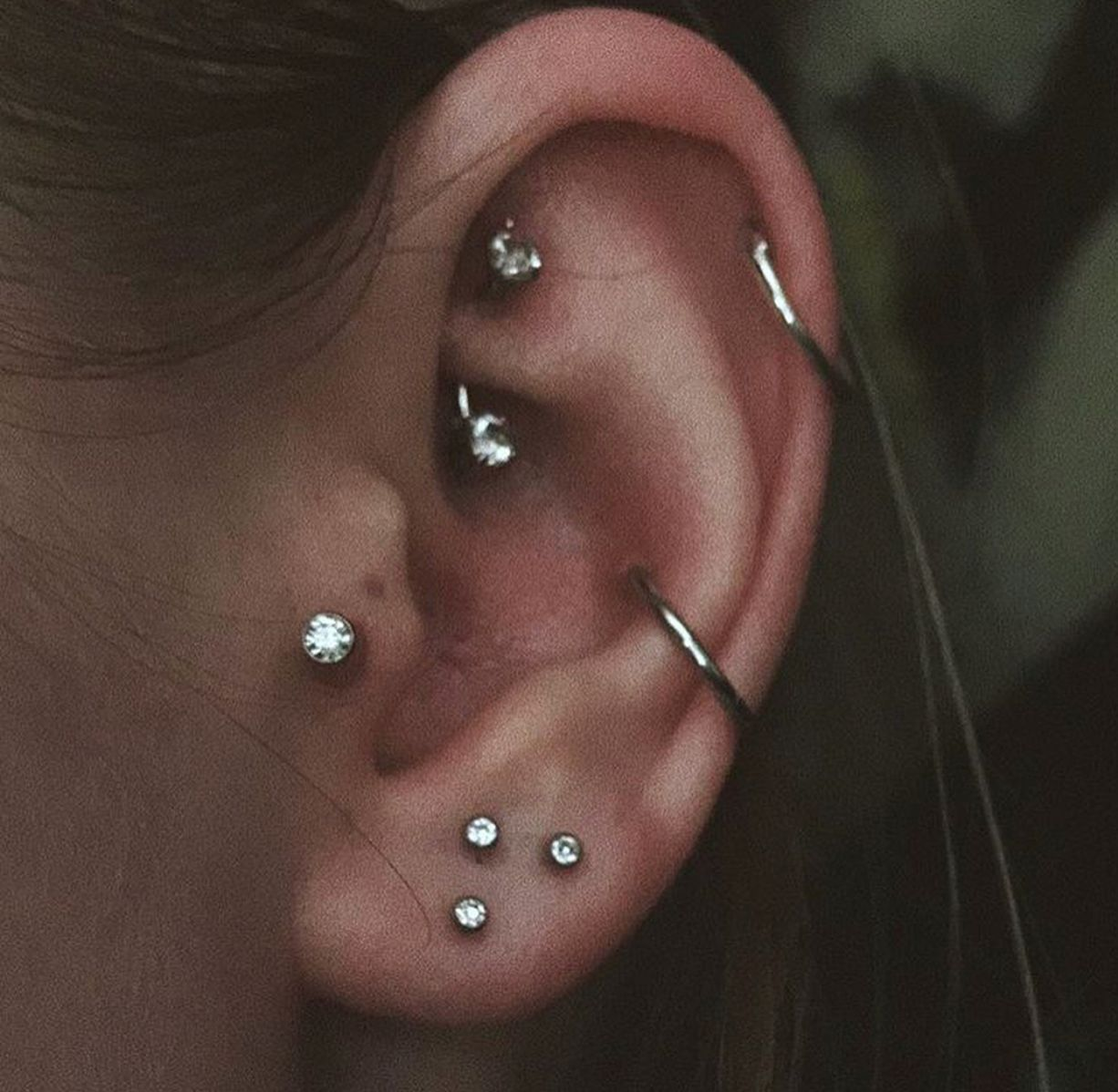 silver curved barbell rook piercing