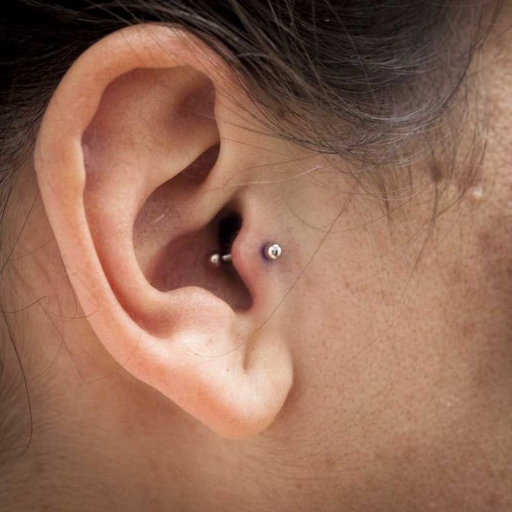 barbell tragus piercing